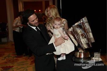 Five-time NASCAR Sprint Cup Series champion Jimmie Johnson places daughter Genevieve Marie next to the Chase for the NASCAR Sprint Cup trophy as wife and mother Chandra looks on
