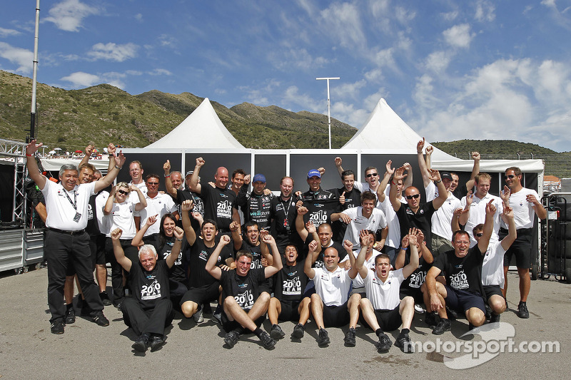 2010 FIA GT1 World champions Andrea Bertolini and Michael Bartels celebrate with Vitaphone Racing team members