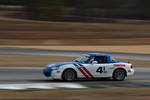 #4 BSI RACING 1991 Mazda Miata Black: Dennis Bize