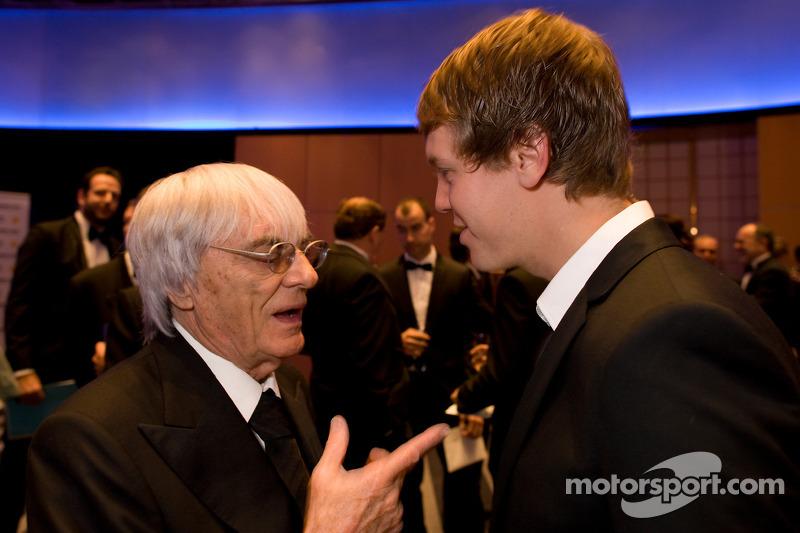 FOM President Bernie Ecclestone and FIA Formula One World Champion Sebastian Vettel