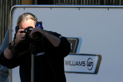 Williams F1 Team mechanic taking pictures of other cars
