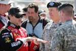 Tony Stewart, Stewart-Haas Racing Chevrolet is speaking with US Army Soldiers
