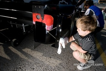A young Spirit of Daytona Racing team member at work