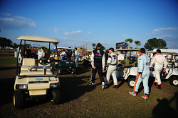 The drivers rush back to their golf carts after the driver shoot