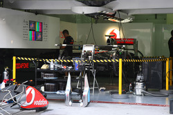 The McLaren behind a barrier for saftey reasons due to KERS