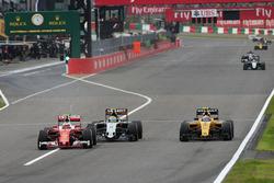 Kimi Raikkonen, Ferrari SF16-H battle for position with Sergio Perez, Sahara Force India F1 VJM09 and Jolyon Palmer, Renault Sport F1 Team RS16