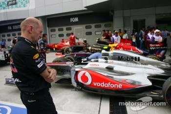 Red Bull's Adrian Newey examining the competition
