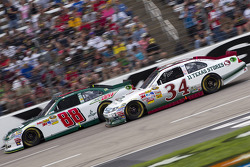 Dale Earnhardt Jr., Hendrick Motorsports Chevrolet and Travis Kvapil, Front Row Motorsports Ford
