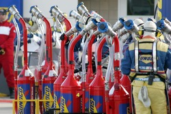 Gas cans sit ready for filling
