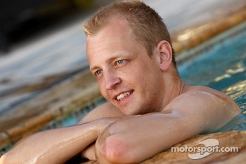 Mikko Hirvonen relaxes in the pool