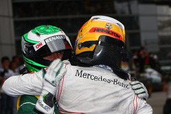 Race winner Lewis Hamilton, McLaren Mercedes and Heikki Kovalainen, Team Lotus