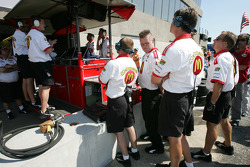 Newman Haas Racing crew members watch the flying lap of Sébastien Bourdais