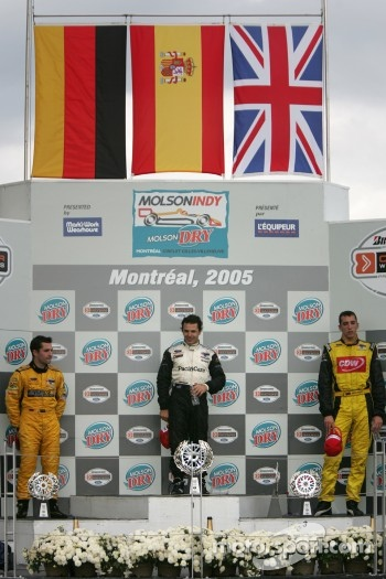 Podium: race winner Oriol Servia with Timo Glock and Justin Wilson