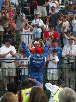 A.J. Allmendinger celebrates with the crowd