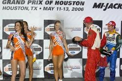 Podium: Sébastien Bourdais and Mario Dominguez spray champagne on the Champ Car girls