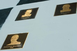 Plaques with images of Sébastien Bourdais and Paul Tracy celebrate their wins
