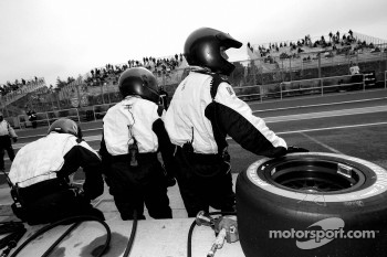 CTE Racing HVM crew members wait for the last pitstop
