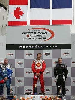 Podium: race winner Sébastien Bourdais with Paul Tracy and Nelson Philippe