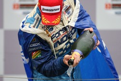Podium: champagne for Paul Tracy
