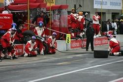 PKV Racing crew members wait for Katherine Legge