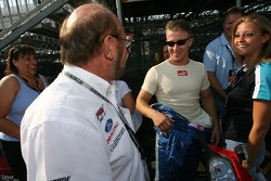 A.J. Allmendinger shares a laugh with Kevin Kalkhoven