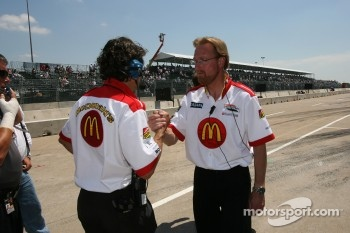 Newman/Haas/Lanigan Racing crew members celebrate as Sébastien Bourdais clinches the provisional pole