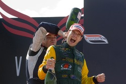 Will Power and Robert Doornbos celebrate