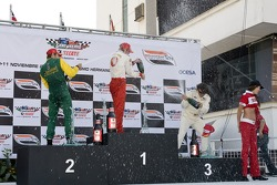 Podium: champagne for Sébastien Bourdais, Will Power and Oriol Servia