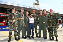 Danica Patrick with Air Force members that will take part of the flyover
