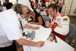 Sébastien Bourdais shares a laugh with Katherine Legge and a fan