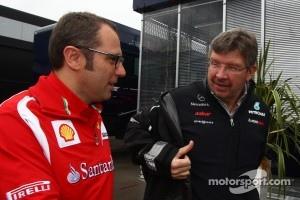 Stefano Domenicali, Scuderia Ferrari Sporting Director and Ross Brawn, Mercedes GP, Technical Director