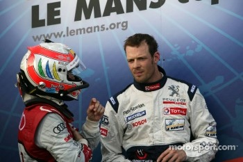 Race winner Alexander Wurz celebrates with this place Tom Kristensen