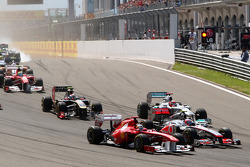 Fernando Alonso, Scuderia Ferrari, Jenson Button, McLaren Mercedes, Michael Schumacher, Mercedes GP F1 Team