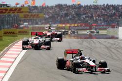 Jenson Button, McLaren Mercedes, MP4-26 leads Lewis Hamilton, McLaren Mercedes, MP4-26