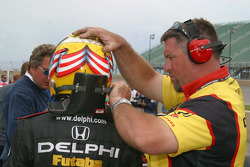 Scott Sharp gets help with his HANS device