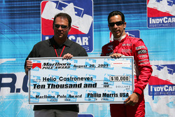 Helio Castoneves accepts pole award check