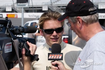 Indy 500 winner Dan Wheldon is interviewed by Robin Miller
