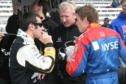 Dario Franchitti confers with Marco Andretti