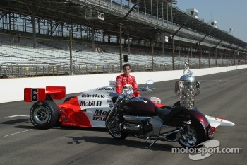 Sam Hornish Jr. admires his new Honda motorcycle