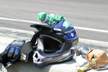 A gegco sits on top of the Geico Team helmet