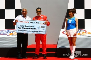 Helio Castroneves receives Pole Award check
