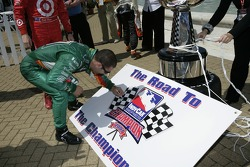 IndyCar Series 2007 Championship contender Tony Kanaan signs a board