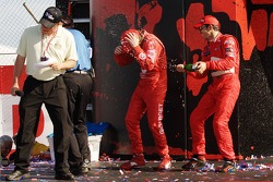 Podium: champagne for Helio Castroneves and Scott Dixon