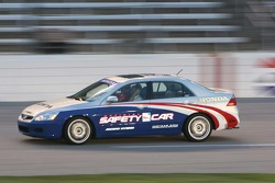 Johnny Rutherford drives the pace car