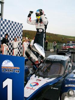 Race winner Alexander Wurz celebrates