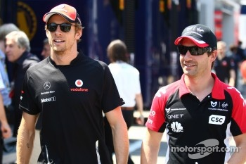 Jenson Button, McLaren Mercedes and Timo Glock, Marussia Virgin Racing