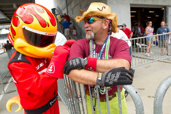 Firehawk signs an autograph for a colorful fan