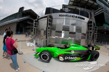 Fans try an IndyCar series car for a photo