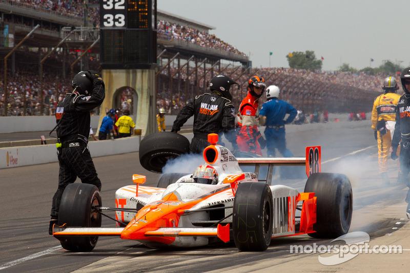 Pit stop for Dan Wheldon, Bryan Herta Autosport with Curb / Agajanian