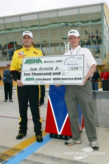 Pole winner Sam Hornish Jr. receiving his check from MBNA